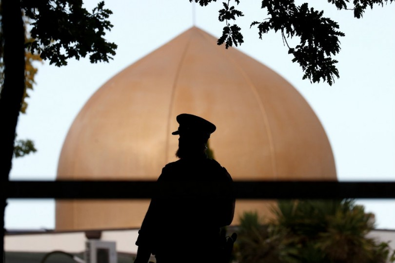 A police officer outside Masjid Al Noor mosque in Christchurch, New Zealand,