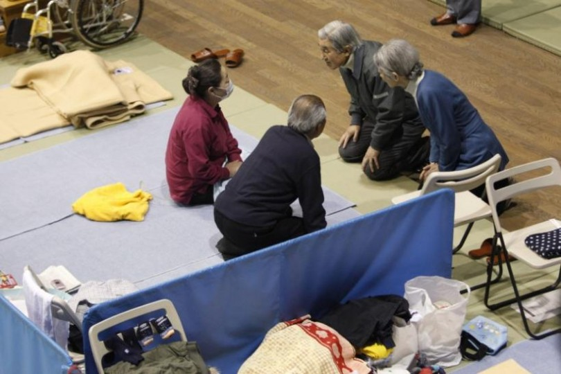Emperor Akihito and Empress Michiko talk with evacuees from the 2011 Tohoku earthquake and tsunami, at an evacuation shelter, in Tokyo on March 31, 2011.