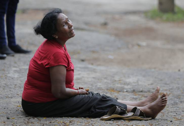A relative of a victim grieves outside a morgue in Colombo.