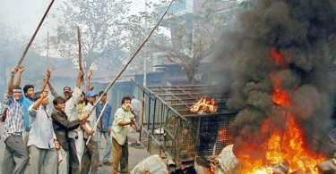 Rioters on the streets of Ahmedabad on February 28, 2002.
