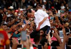 Joko Widodo takes pictures with his supporters during his first campaign rally at a stadium in Serang, Banten province, Indonesia on March 24, 2019 .