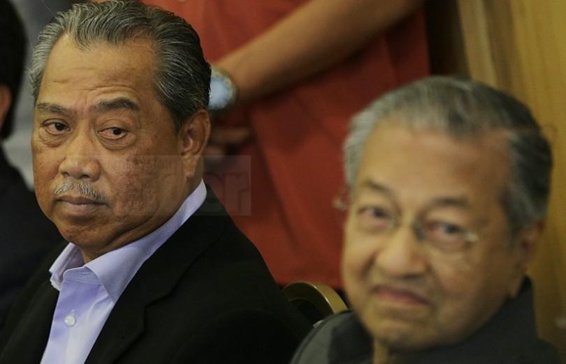 Tan Sri Muhyiddin Yassin and Tun Dr Mahathir Mohamad.