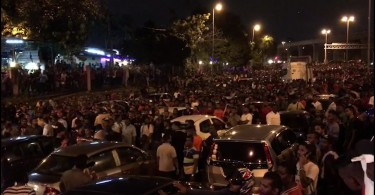 The crowd and the chaos on the main road outside the temple at the height of the rioting.