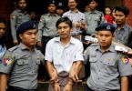 Reuters journalists Kyaw Soe Oo and Wa Lone were escorted by police after a court hearing in August last year.