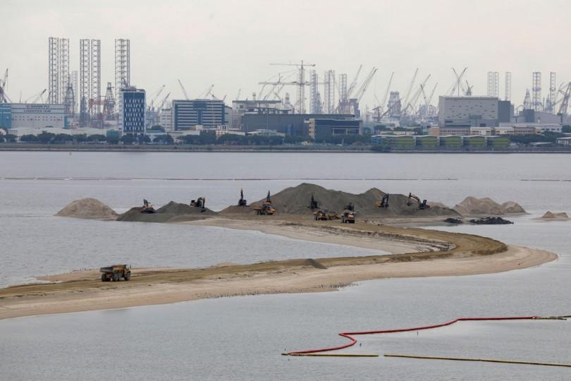 Land reclamation near Singapore's Tuas industrial area.