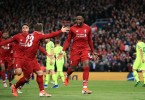 Origi (centre) celebrates scoring Liverpool's decisive  fourth goal to upset and knockout Barcelona.