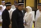 Mukhriz walking past the Johor royalty at yesterday's funeral.