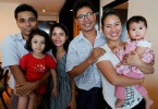 From left, Kyaw Soe Oo with his daughter and wife Chit Su Win. Wa Lone with wife Pan Ei Mon and their daughter.
