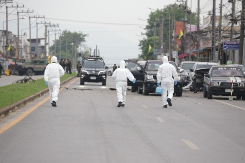 Members of a bomb disposal unit at the scene of the blast.