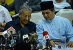 Tun Dr Mahathir Mohamad and Datuk Seri Mohamed Azmin Ali.