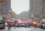 Emergency vehicles fill the street at the scene after a helicopter crashed atop a building in Times Square and caused a fire in the Manhattan borough of New York.