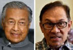 People are not convinced that Anwar (right) will take over from Mahathir (left) despite the latter's oft repeated assurances.