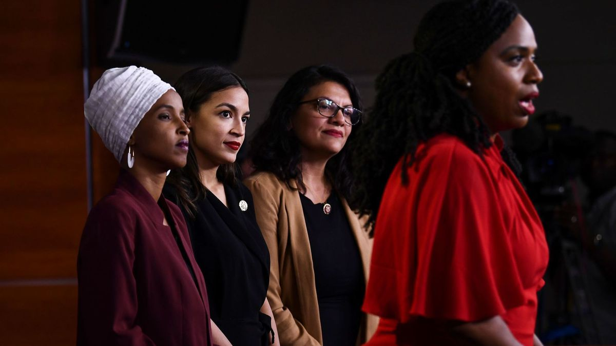 Ayanna Pressley speaks to reporters as (from left) Ilhan Omar , Alexandria Ocasio-Cortez and Rashida Tlaib look on.