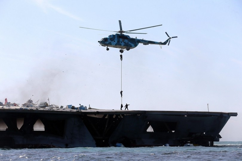 Iran's elite Revolutionary Guard troops rappel down a helicopter on a naval vessel during a military drill in the Strait of Hormuz in southern Iran.