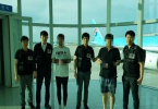 South Korean police officers with two of the suspects detained in Malaysia.