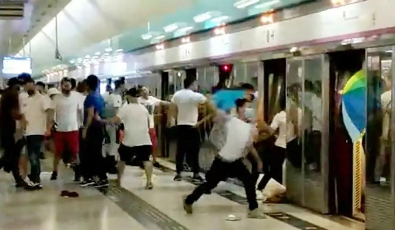 Suspected Triad members, clad in white t-shirts and some armed with poles, flooded into the rural Yuen Long station and stormed a train, attacking passengers.
