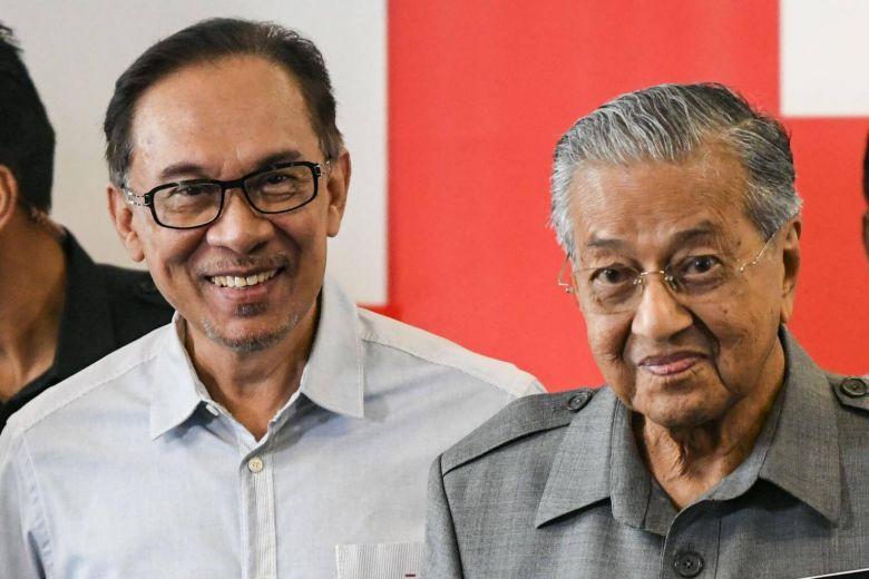 Datuk Seri Anwar Ibrahim and Tun Dr Mahathir Mohamad.