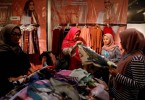 Women shop for hijabs at a stall at Muslim Fashion Festival in Jakarta.