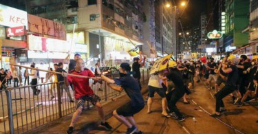 A group of men, believed to be triad members attacking the black-clad protesters in Hong Kong North Point.
