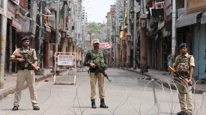 Security forces enforces a lock-down throughout  Kashmir following the Indian government's decision to revoke the region's special status.