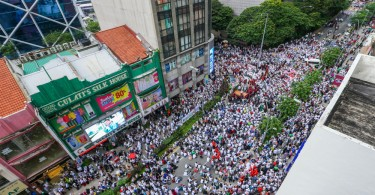 A section of the hundreds of thousands of supporters in the streets of KL for the Umno-PAS alliance signed Saturday at PWTC.