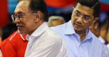 Anwar (left) and Azmin are not quite looking in the same direction now.
