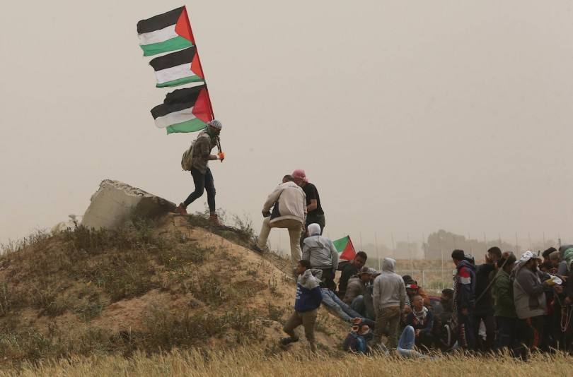 Palestinian protesters gather during a demonstration demand the right to return to their homeland at the Israel-Gaza border
