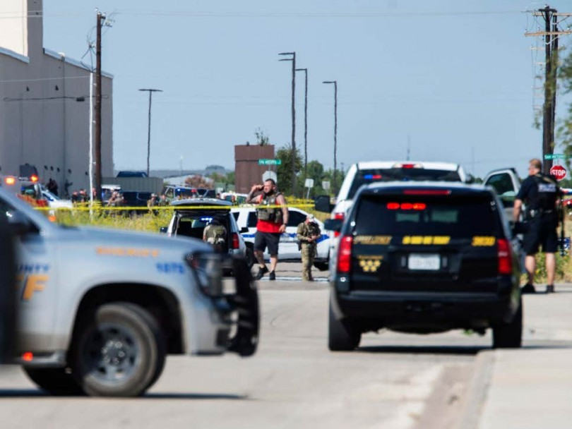 Police surround the gunman before shooting him dead.
