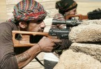 Frontline Kurdish fighters taking aim in Northern Syria.