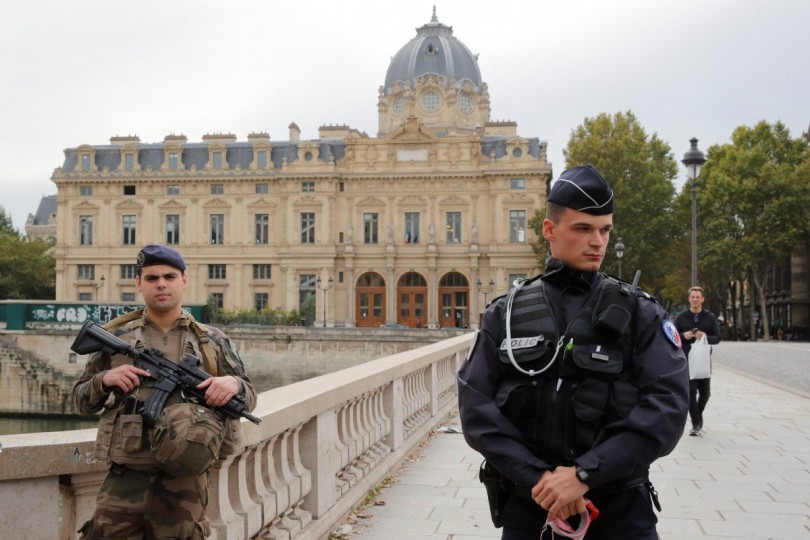Police secure the area in front of the Paris police headquarters.